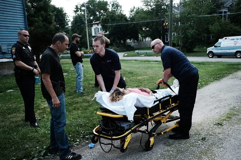 WARREN, OH - JULY 14: Medical workers and police treat a woman who has overdosed on heroin, the second case in a matter of minutes,  on July 14, 2017 in Warren, Ohio. According to recent statistics, at least 4,149 Ohioans died from drug overdoses in 2016, a 36 percent leap from just the previous year and making Ohio the leader in the nation's overdose deaths.  (Photo by Spencer Platt/Getty Images)
