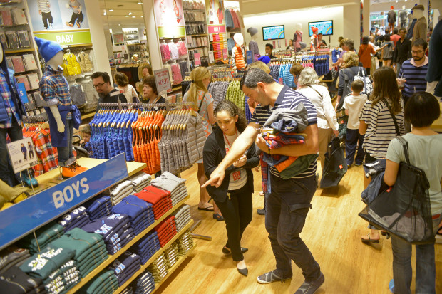 (Natick, MA, 08/29/14) Grand opening of Uniqlo at the Natick Mall.  Shoppers packed the store Friday morning.  Friday, August 29, 2014. Staff photo by Ted Fitzgerald
