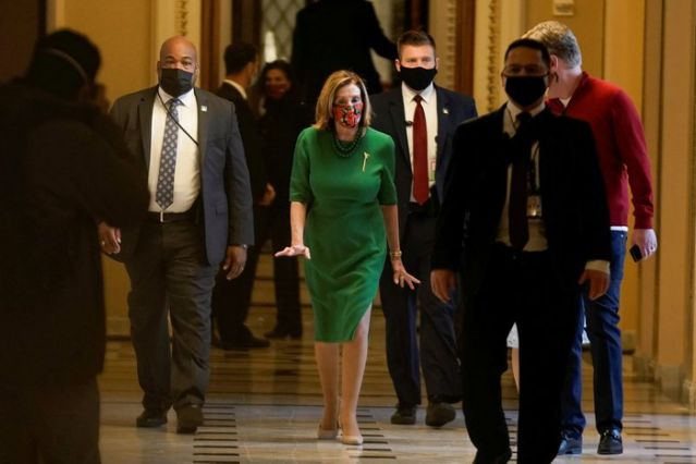Speaker of the House Nancy Pelosi (D-CA) walks back to her office after opening the House floor following an agreement of a coronavirus disease (COVID-19) aid package the night before on Capitol Hill, Washington, D.C., U.S., December 21, 2020. REUTERS/Ken Cedeno