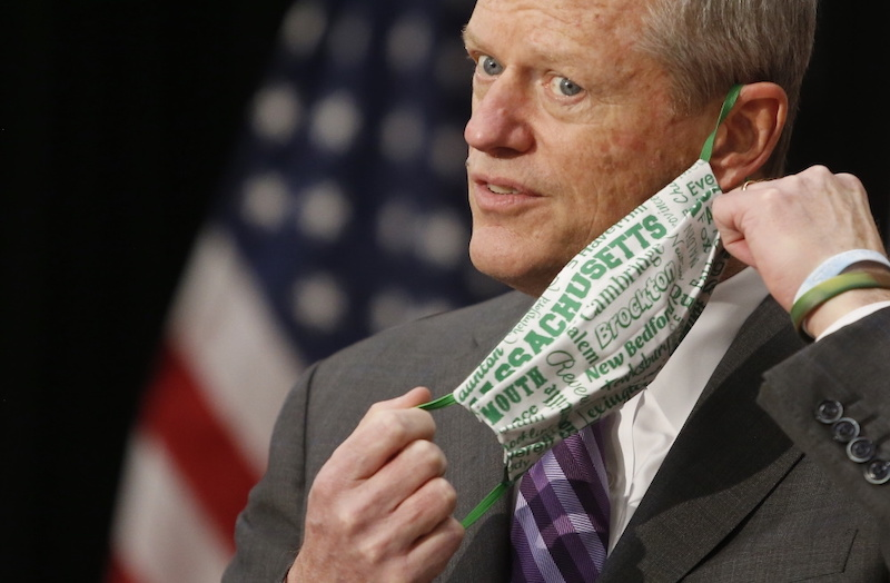 Boston, MA -- 4/26/21 -- Massachusetts Governor Charlie Baker removes his mask as he steps to the microphone during a Road Safety Legislation Announcement at the State House. (Jessica Rinaldi/Globe Staff)